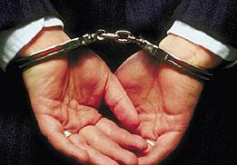 Corporate criminal in handcuffs uid 1009908