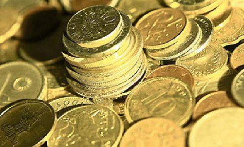 Pile of international coins uid 1177795