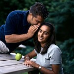 couple at picnic table uid 1186865